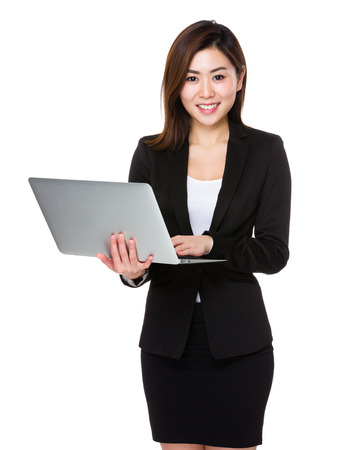 computer use: Asian businesswoman use of the laptop computer