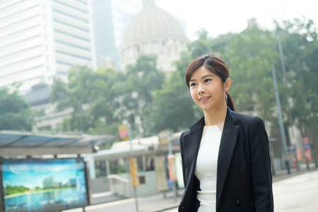 far away look: Asian Businesswoman walking at outdoor Stock Photo
