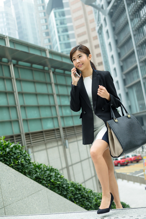 far away look: Business woman talk to mobile phone at outdoor
