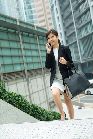hear business call: Young Business woman chat on mobile phone Stock Photo