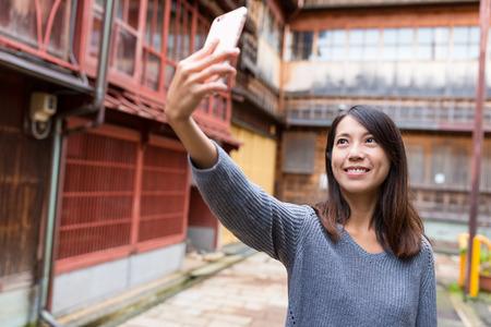 Woman visit Japan and taking photo