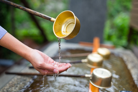 Tradition of hand washing before entering the temple in Japan