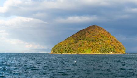 Island with autumn landscape