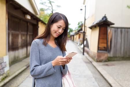Womna use of mobile phone in Kanazawa Stock Photo