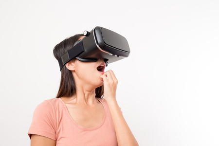 Asian Woman looking though Virtual reality glasses and feeling scary
