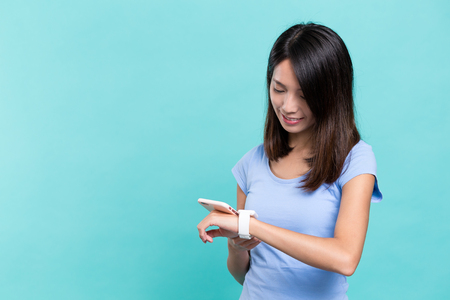 Woman use of smart watch connect with cellphone