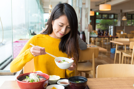 Woman having lunch Foto de archivo