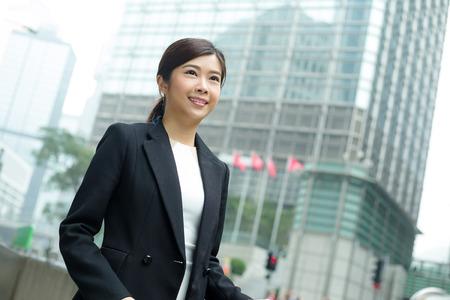far away look: Businesswoman at outdoor Stock Photo