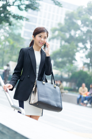 Asian Business woman talk to mobile phone Stock Photo
