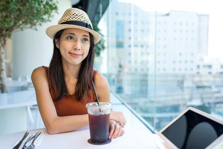 far away look: Woman enjoy her coffee in cafe