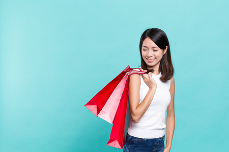 Woman holding shopping bag Stock Photo
