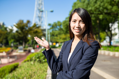 Young businesswoman showing a open palm Stock Photo