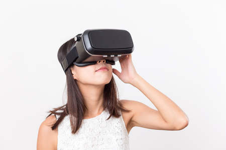 virtual reality simulator: Asian Woman watching with VR device Stock Photo