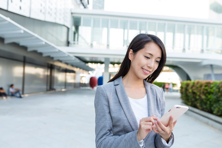 account executive: Business woman use of cellphone Stock Photo
