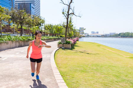 Woman use of smart watch for running