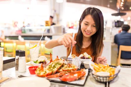 Woman enjoy her dinner Banque d'images