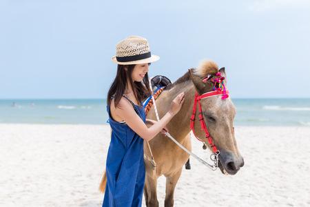 caress: Woman caress on horse Stock Photo