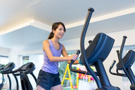 Woman training on Elliptical Cross Trainer