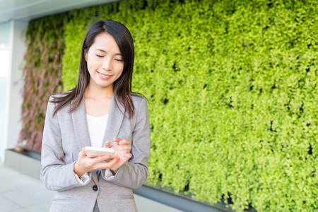 Business woman use of mobile phone Stock Photo
