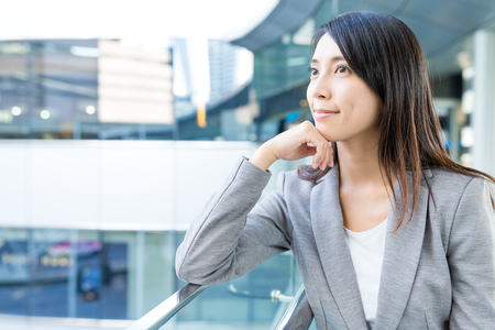 Businesswoman looking far away at outdoor Stock Photo