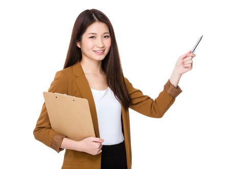 Young woman with clipboard and pen point up Stock Photo