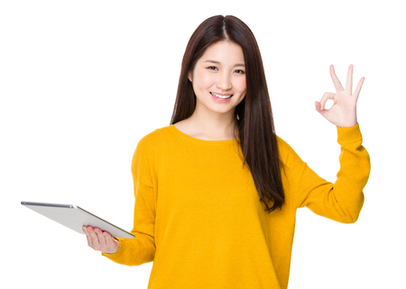 Asian woman hold with tablet and ok sign Stock Photo