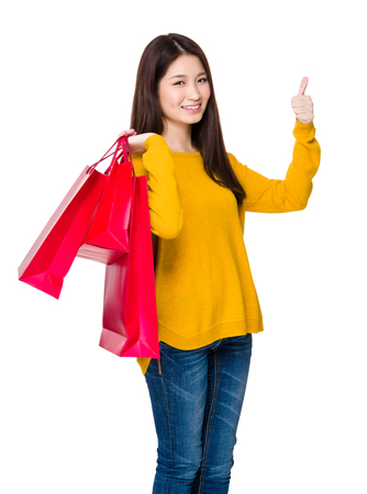 Woman hold with paper bag and thumb up Stock Photo