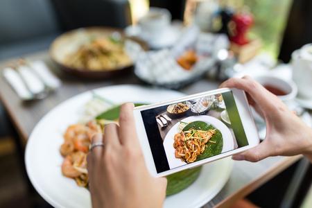 Woman taking photo on food