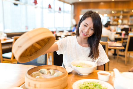 Woman enjoy in chinese restaurant Stock Photo