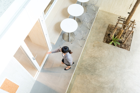 Top view of business woman entering the office Stock Photo