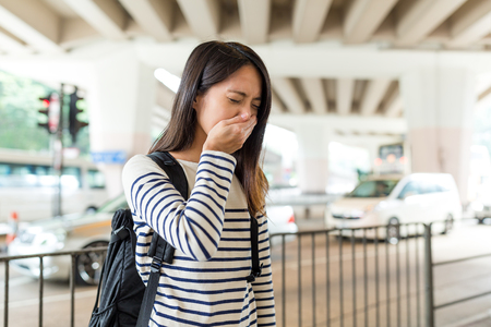 Woman suffer from nose allergy