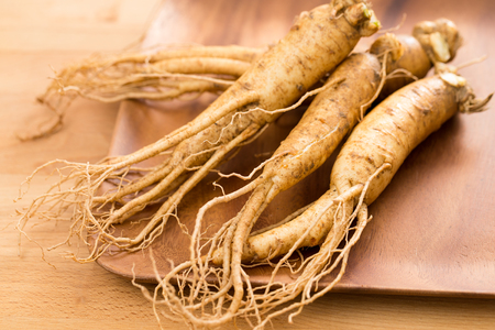 Fresh Korean Ginseng over wooden plate