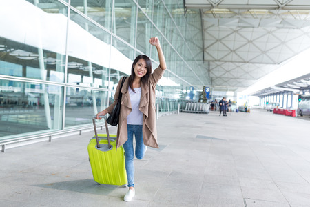 thrilled: Thrilled woman going travel Stock Photo