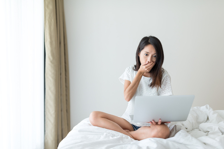 Woman feeling scary on laptop computer Stock Photo