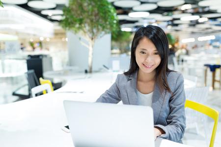 Businesswoman working on laptop computer