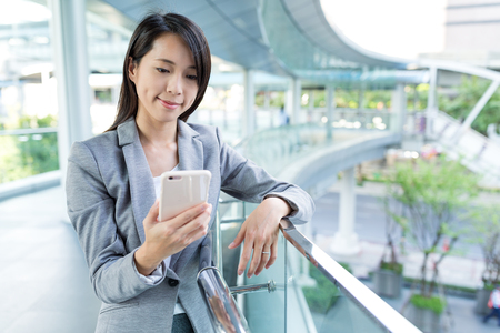 Business woman working on cellphone Stock Photo