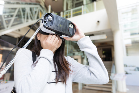 terrifying: Woman watching though VR device