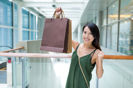 plaza of arms: Excited woman holding shopping bag