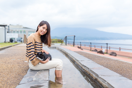 Woman enjoy her foot onsen at outdoor Stock Photo