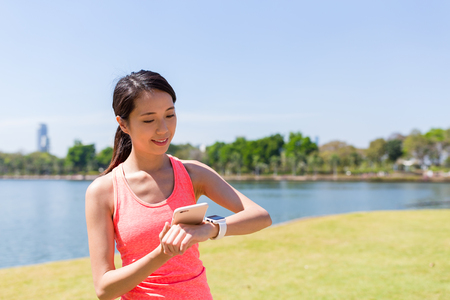 benjakitti: Woman using smart watch and ready for running