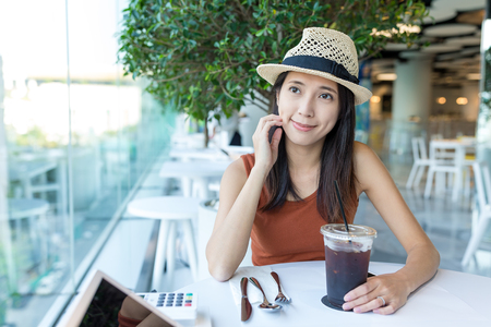 far away look: Woman having coffee in cafe