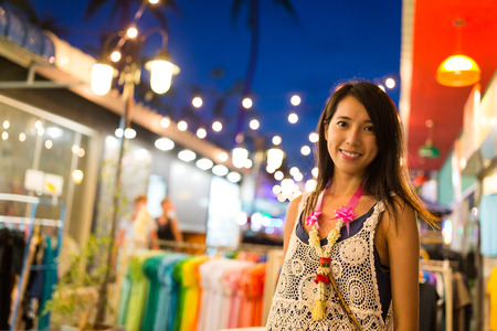 Woman shopping at the street in Thailand at night Stock Photo
