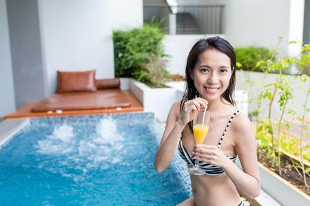 Woman with bikini enjoy in spa and drinking