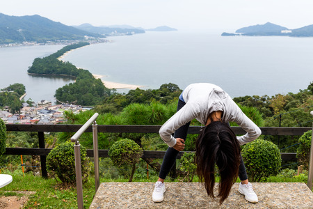 Woman upside down and viewing of Amanohashidate in Kyoto Stock Photo