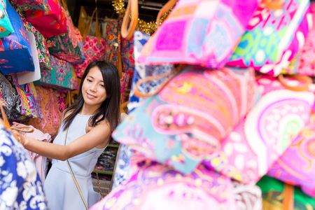 chose: Woman shopping in the market Stock Photo