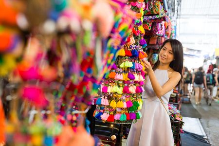 Young woman go shopping in the street market Stock Photo