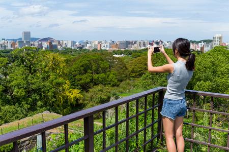 Woman taking photo in fukuoka city
