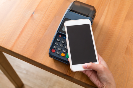 check out: Pay money on POS machine Stock Photo