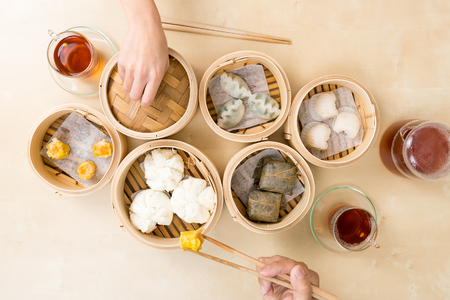 Top view of people eating dim sum