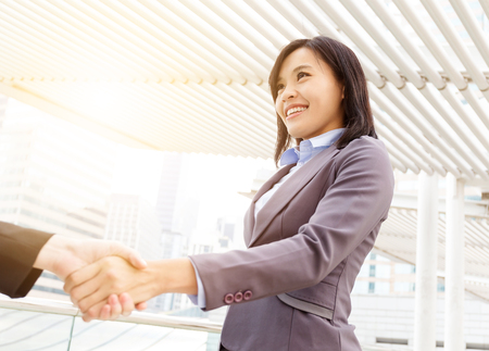 associate: Business woman shaking hand with other Stock Photo